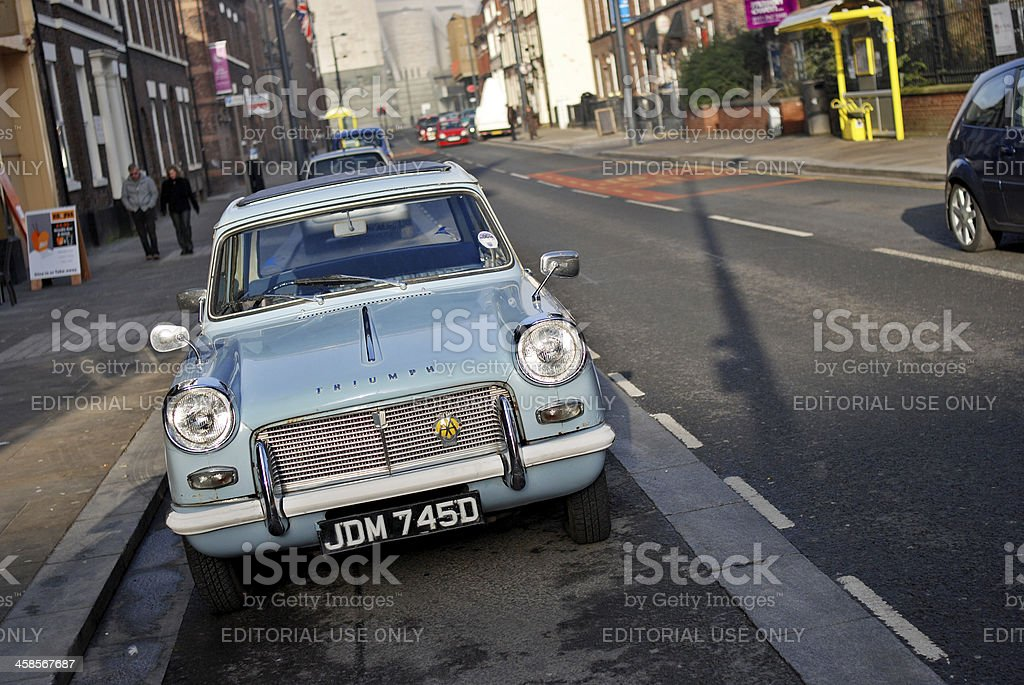 Front of a turquoise Triumph Herald in Hope Street, Liverpool. stock photo