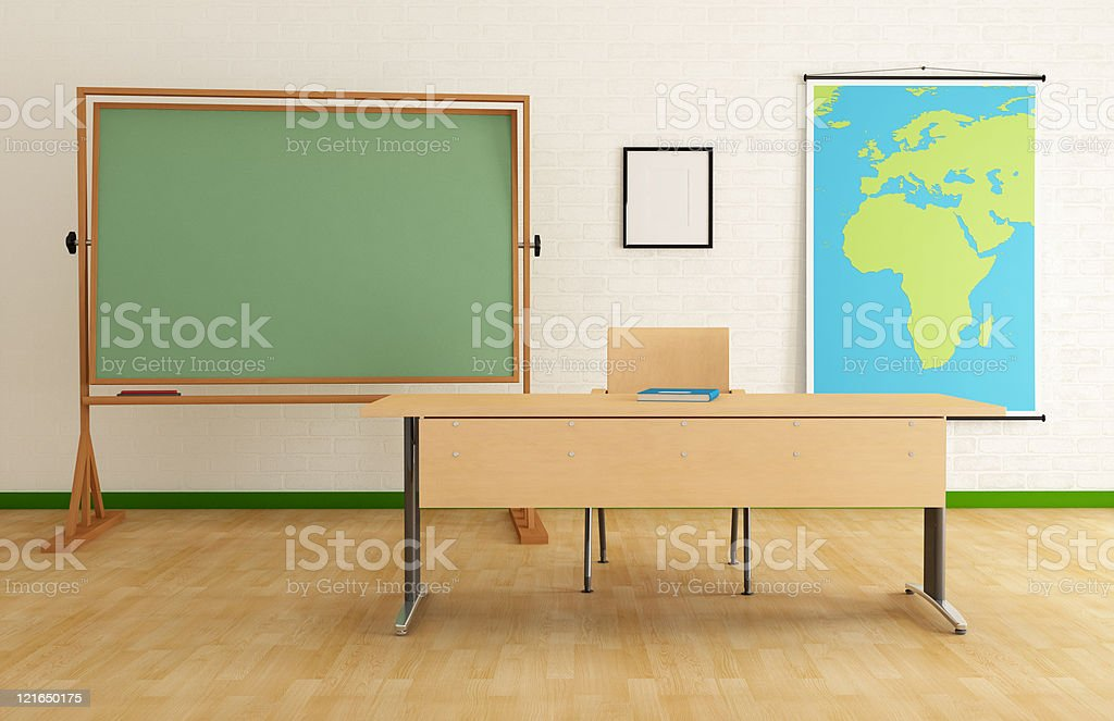 Front of classroom with desk, blackboard and map of Africa royalty-free stock photo