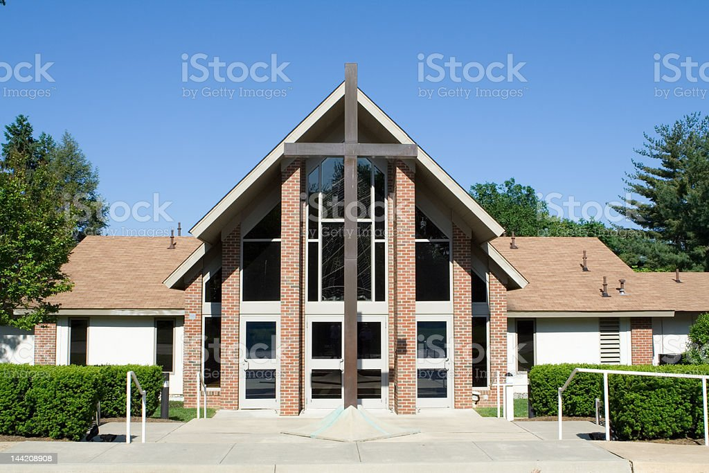 Front of Modern Church with Large Cross, Blue Sky stock photo