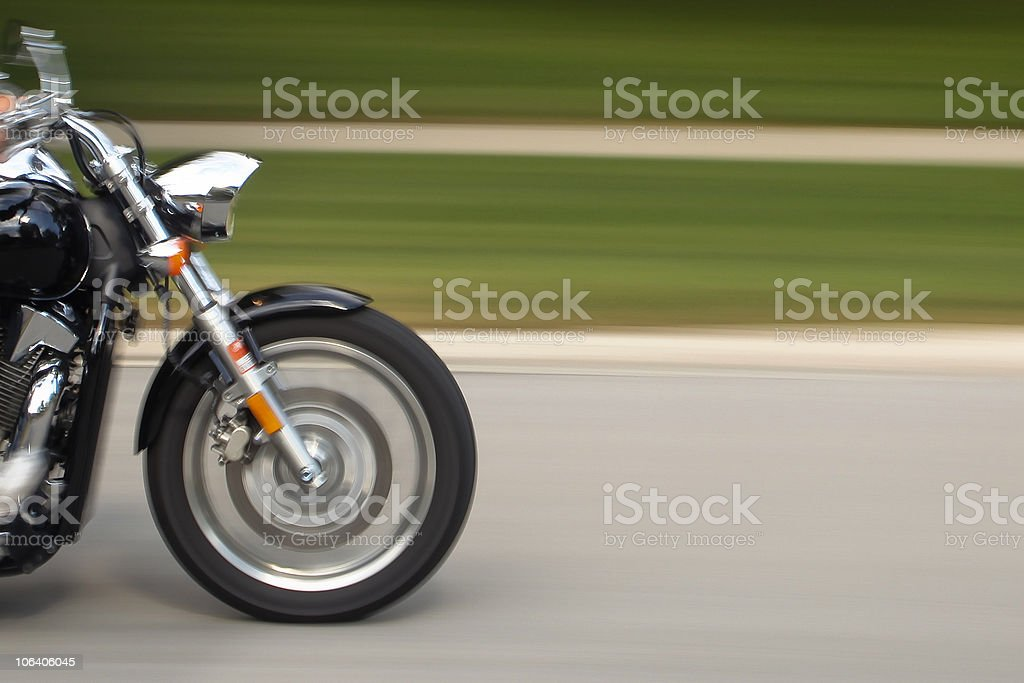 Front of motorcycle passing by stock photo