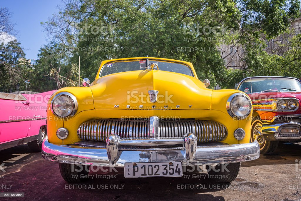 Front of of a yellow classic american Ford Mercury car stock photo