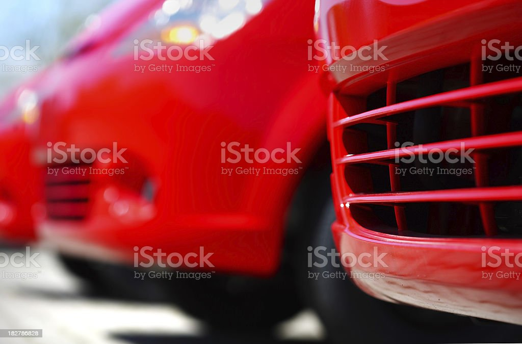 Front of red new cars in a row at dealership royalty-free stock photo