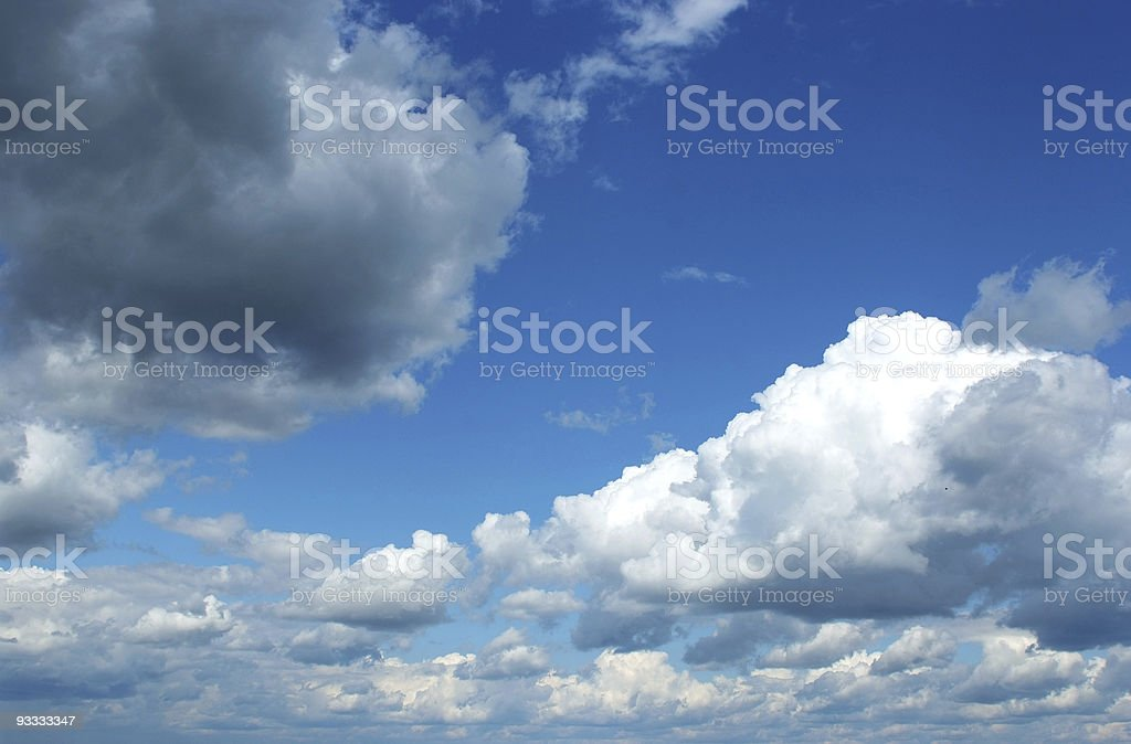 front of storm clouds over blue sky royalty-free stock photo