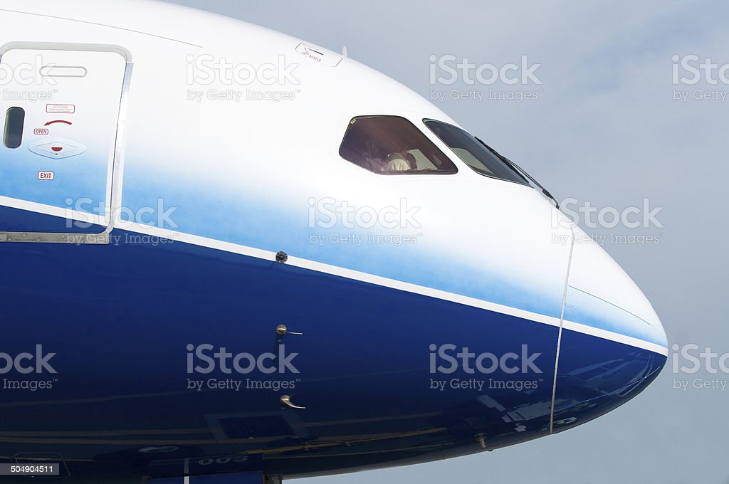 Front of wide-body airplane stock photo