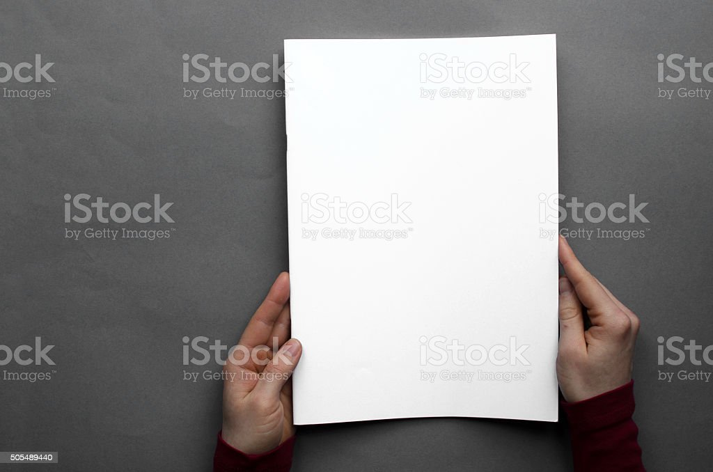 Front page of paper brochure photographed from above stock photo