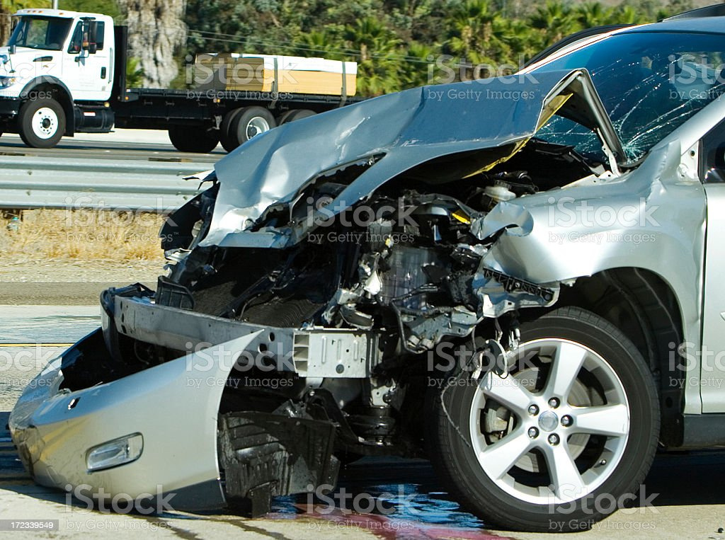 Front part of car completely damaged after crash stock photo