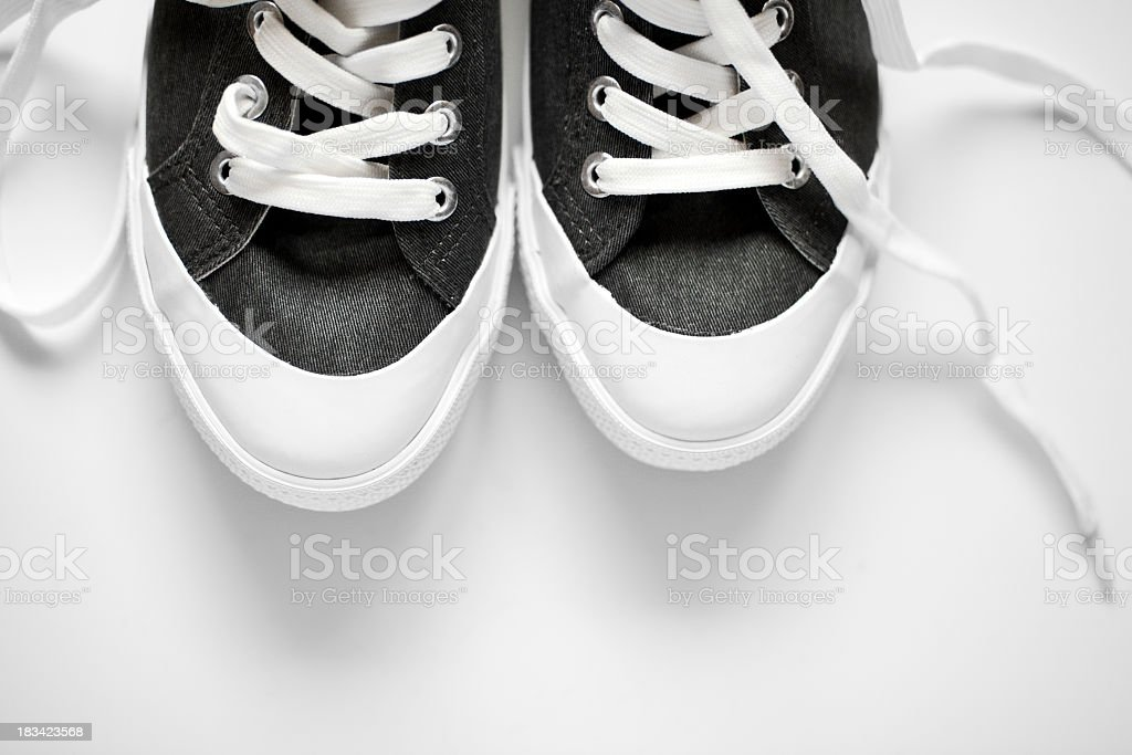 front part of new sneakers on grey background royalty-free stock photo