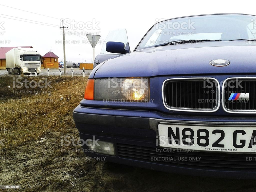 Front part of parked BMW M3 (E36) on roadside royalty-free stock photo