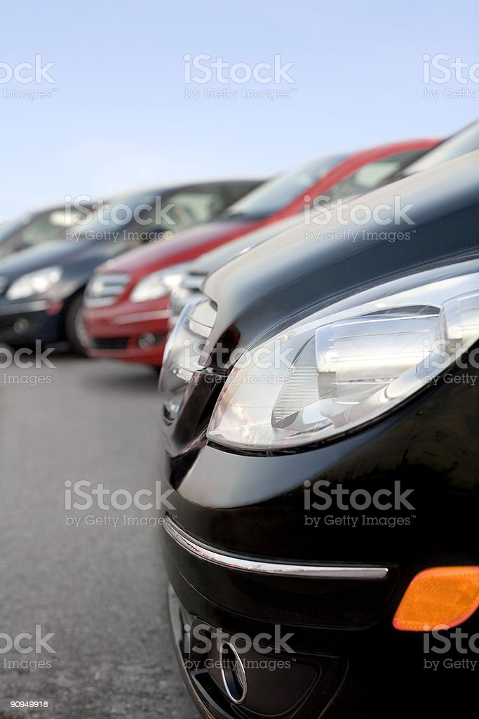 Front part of parked cars on a row stock photo