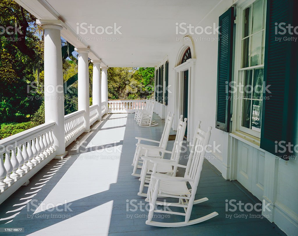 Front porch and rocking chairs (P) stock photo