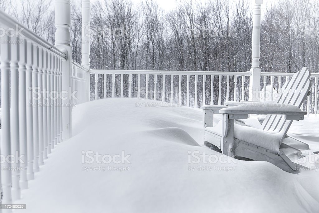 Front porch in a snowstorm royalty-free stock photo