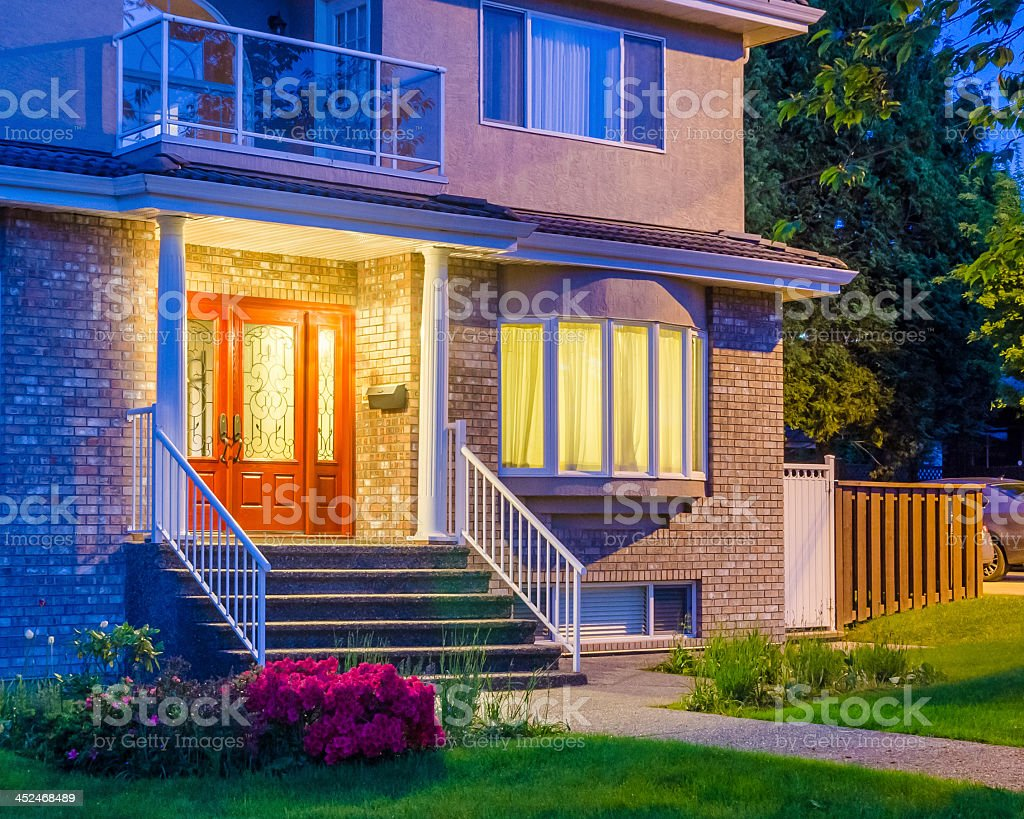 Front porch of a suburban house at dusk stock photo