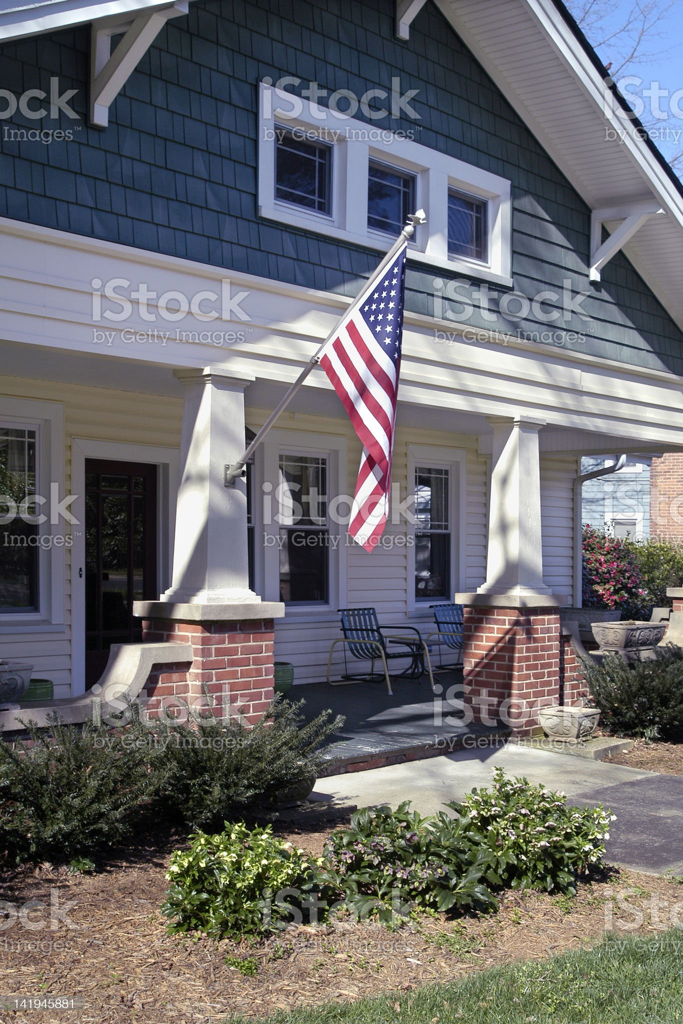 Front Porch with an American Flag royalty-free stock photo
