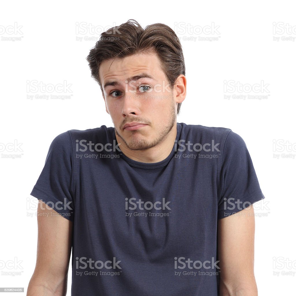 Front portrait of a young man doubting shrugging shoulders stock photo