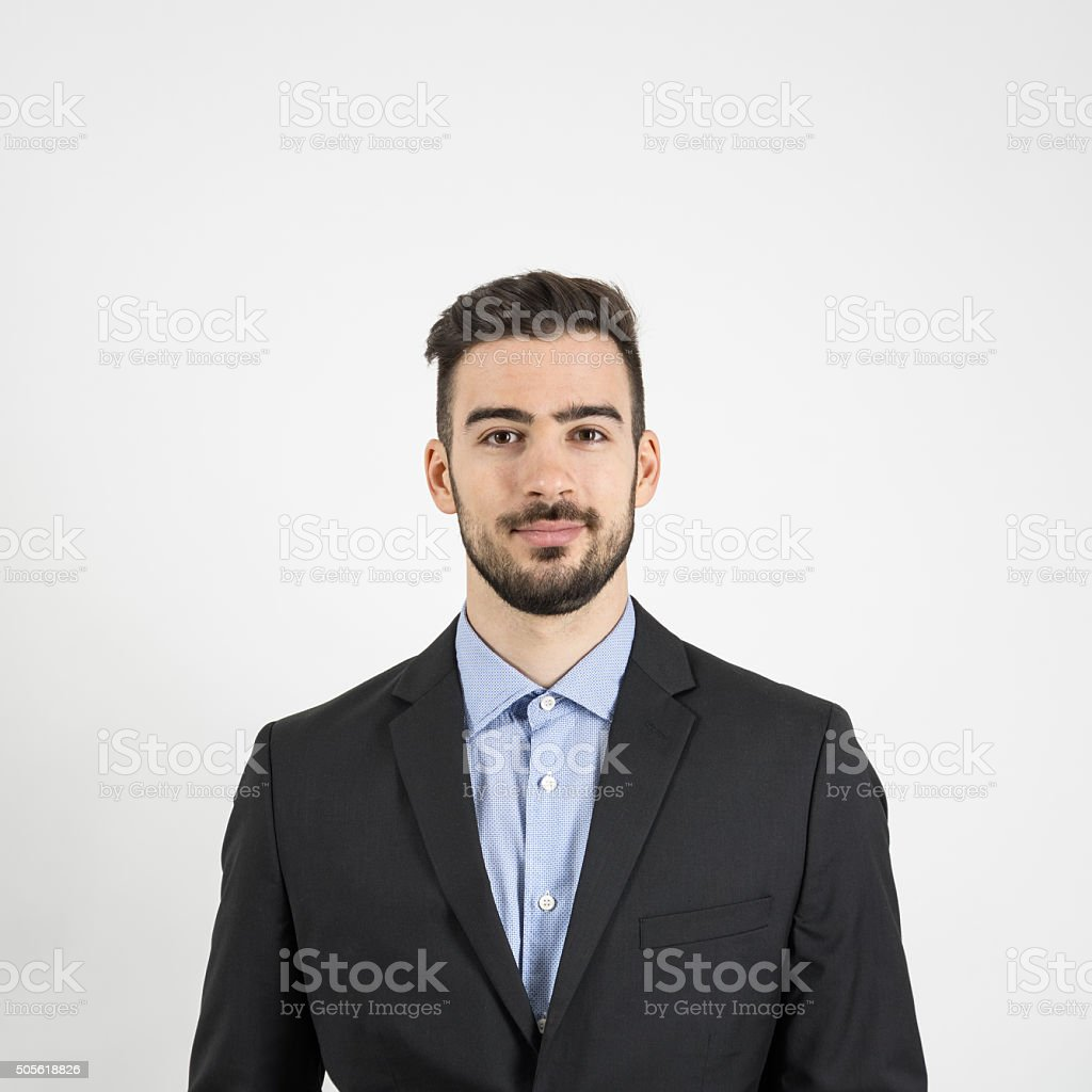 Front portrait of young man in suit and blue shirt stock photo