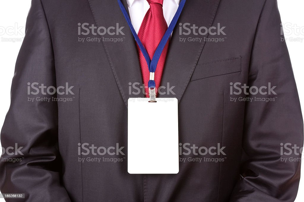 Front shot of a businessman wearing a blank name tag stock photo