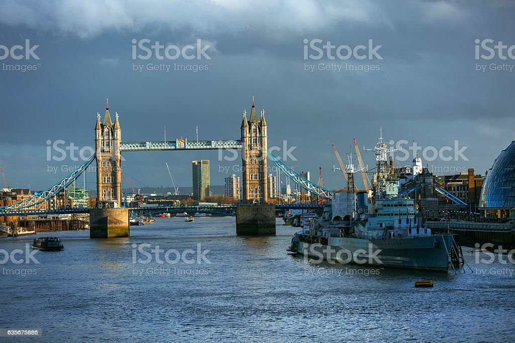Front view at London bridge and dock under dramatic sky stock photo