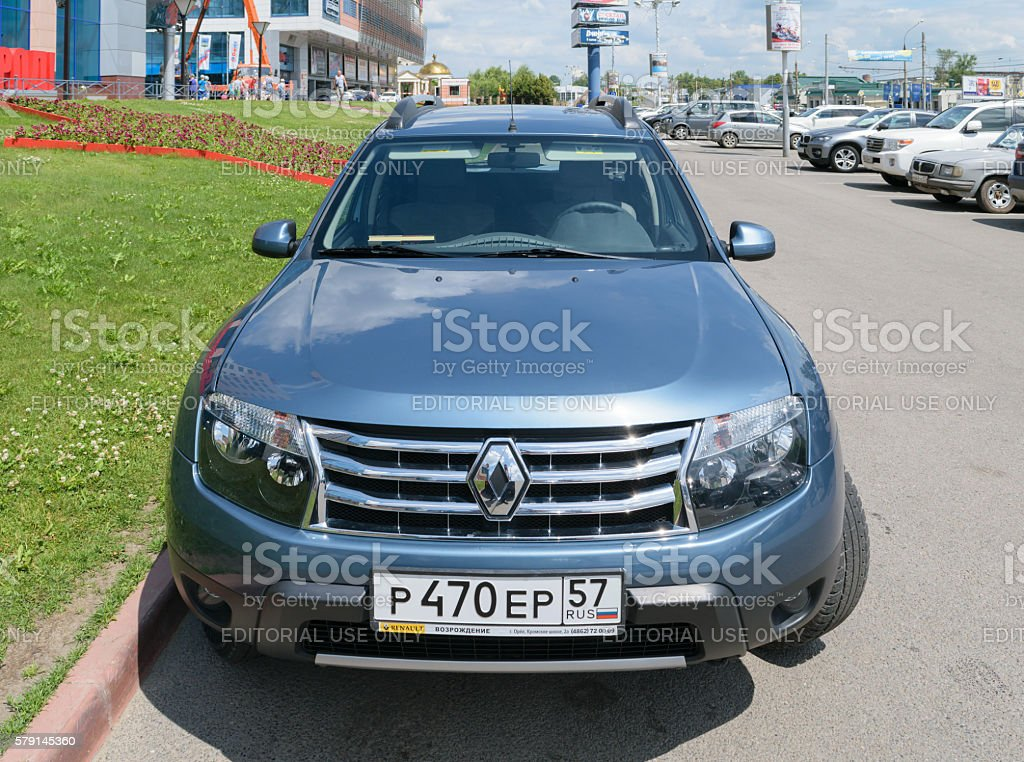 Front view of a blue passenger car Renault Duster stock photo