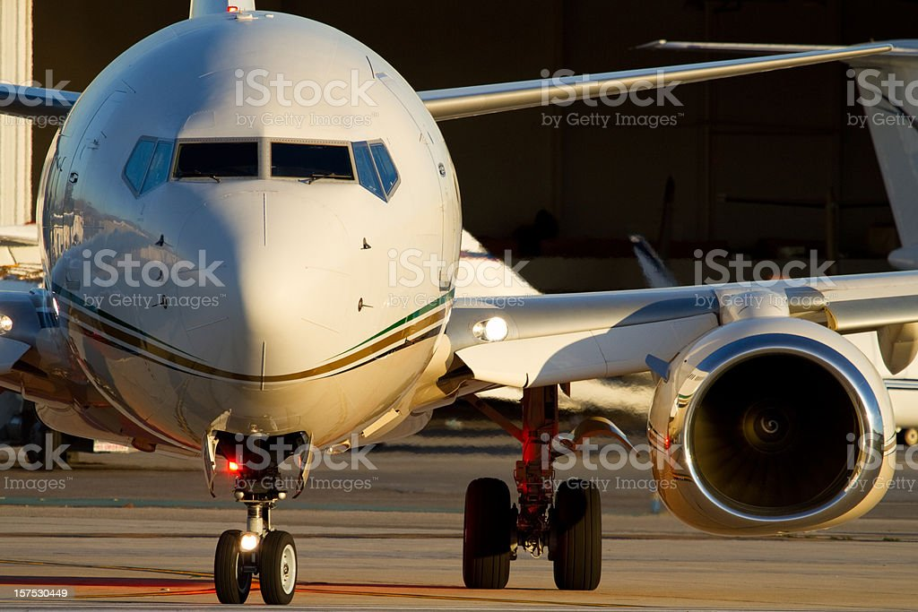 Front view of a business jet on the runway stock photo