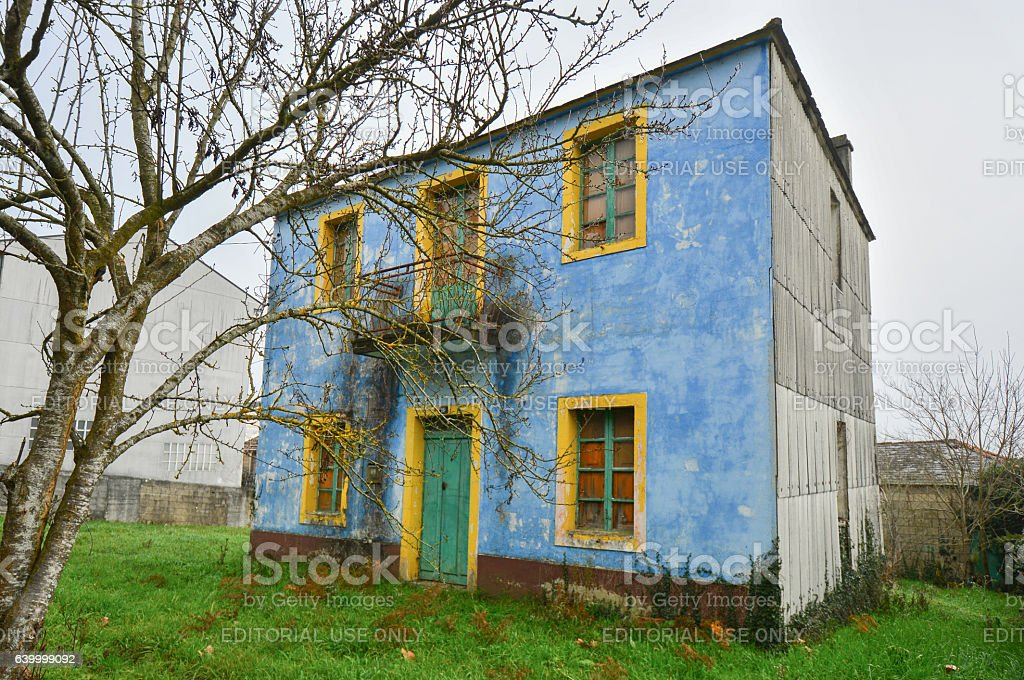 Front view of a colorful abandoned house stock photo