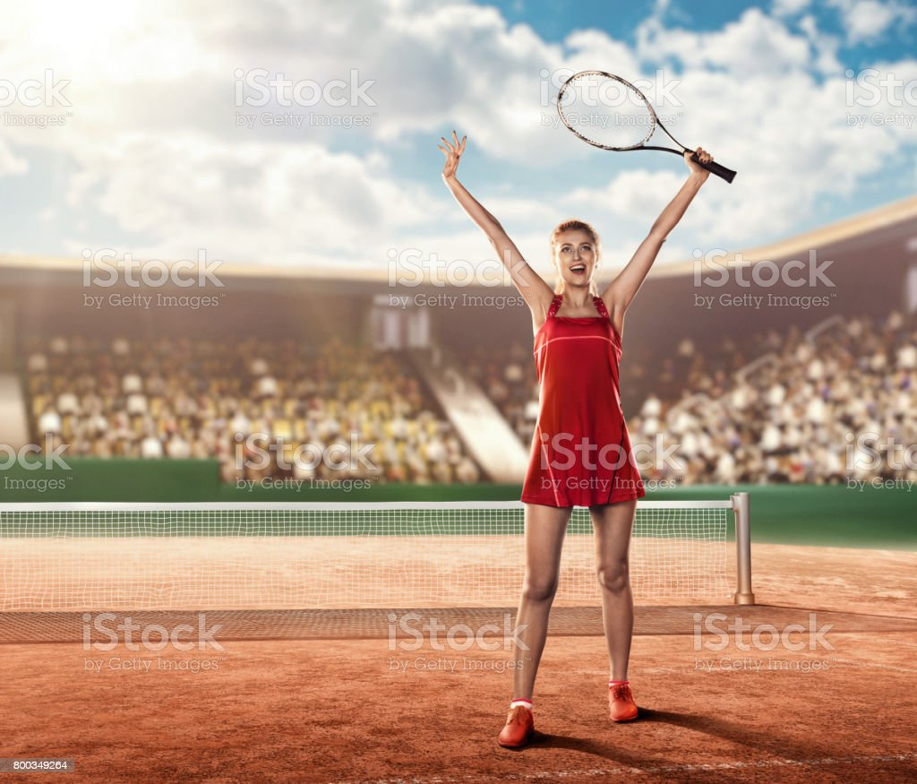 front view of a female tennis player on court  holding a tennis racket stock photo