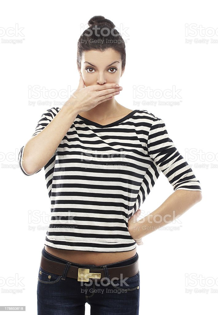 Front view of a girl, covering his mouth. royalty-free stock photo