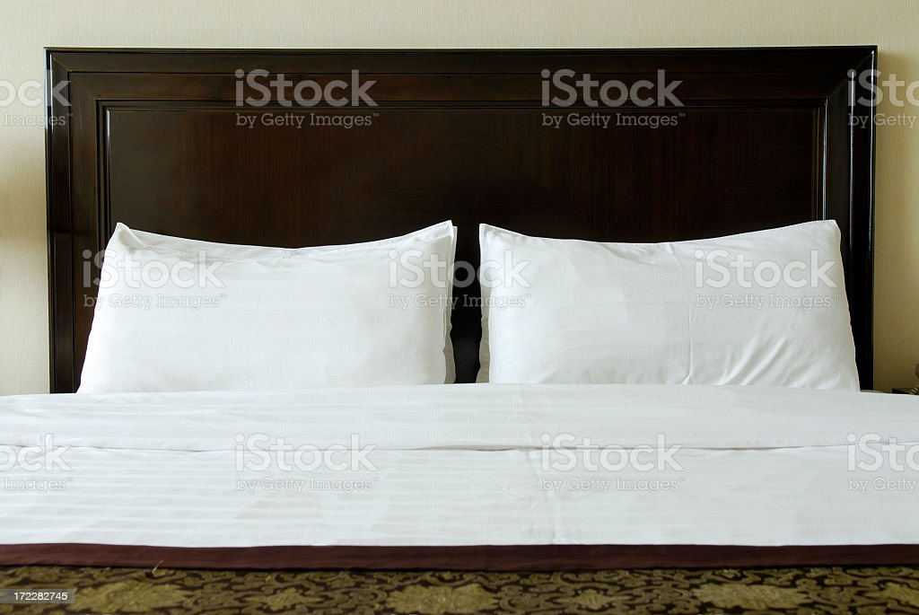 Front view of a luxury bed with white sheets  stock photo