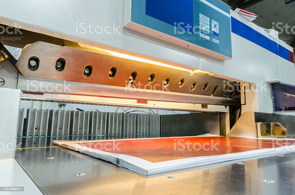 Front view of a modern paper guillotine with touch screen royalty-free stock photo
