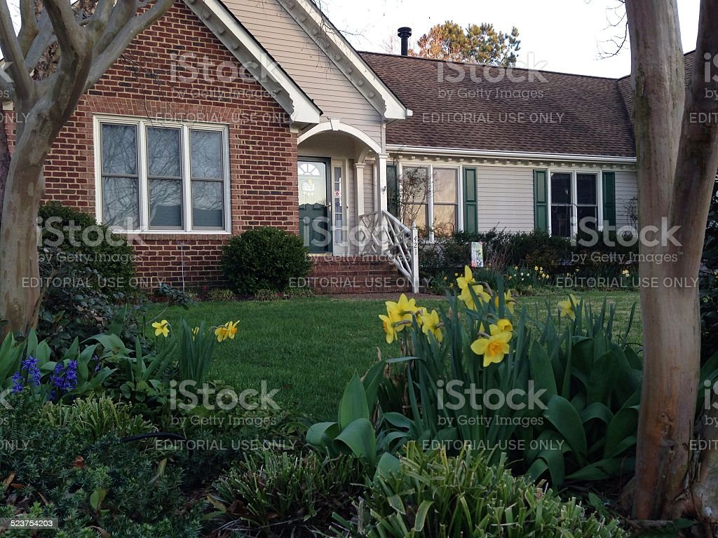 Front view of a residential brick home stock photo