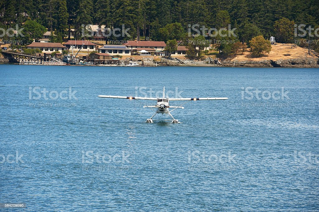 Front view of a seaplane taxiing stock photo