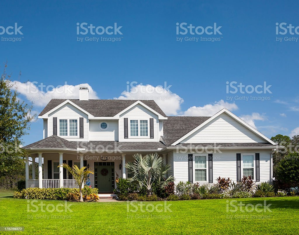 Front view of a Traditional American Home with wrapped porch stock photo