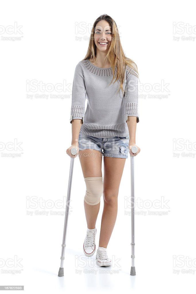 Front view of a woman walking with crutches stock photo