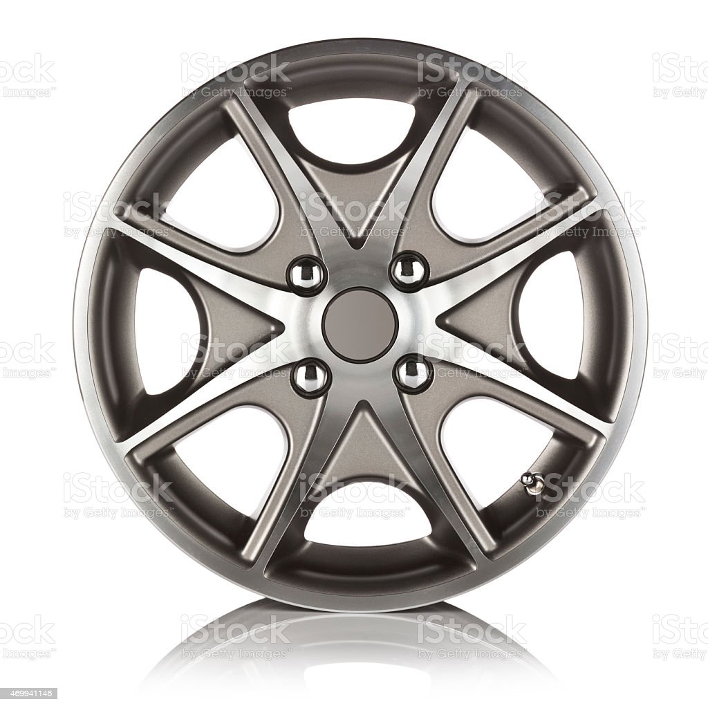 Front view of an alloy wheel on reflective white backdrop stock photo