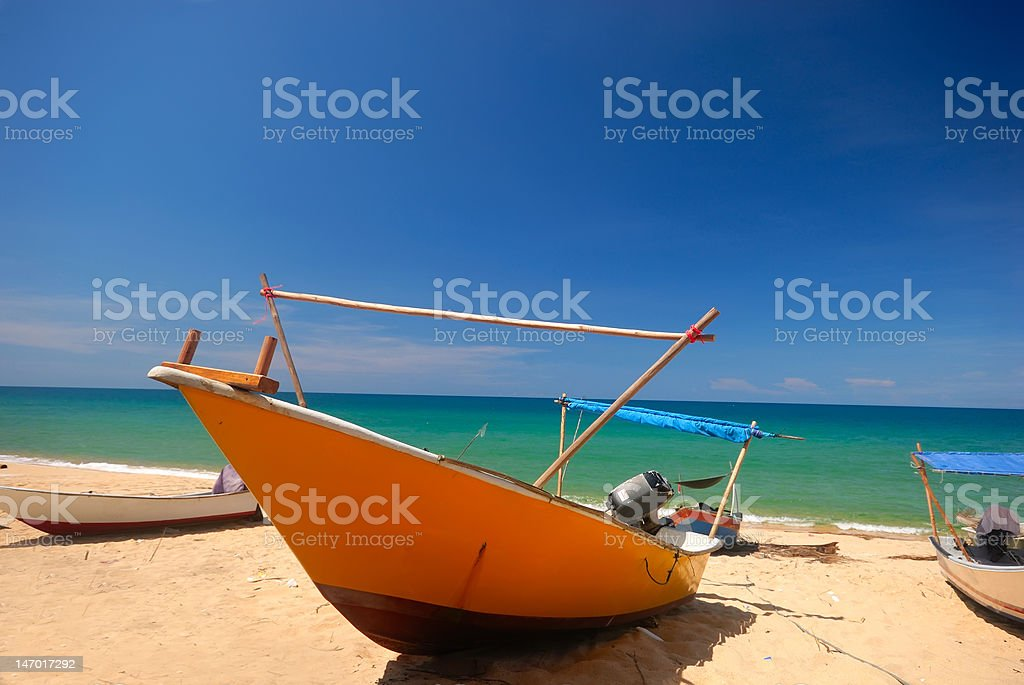 Front view of an anchored fishing boat. stock photo