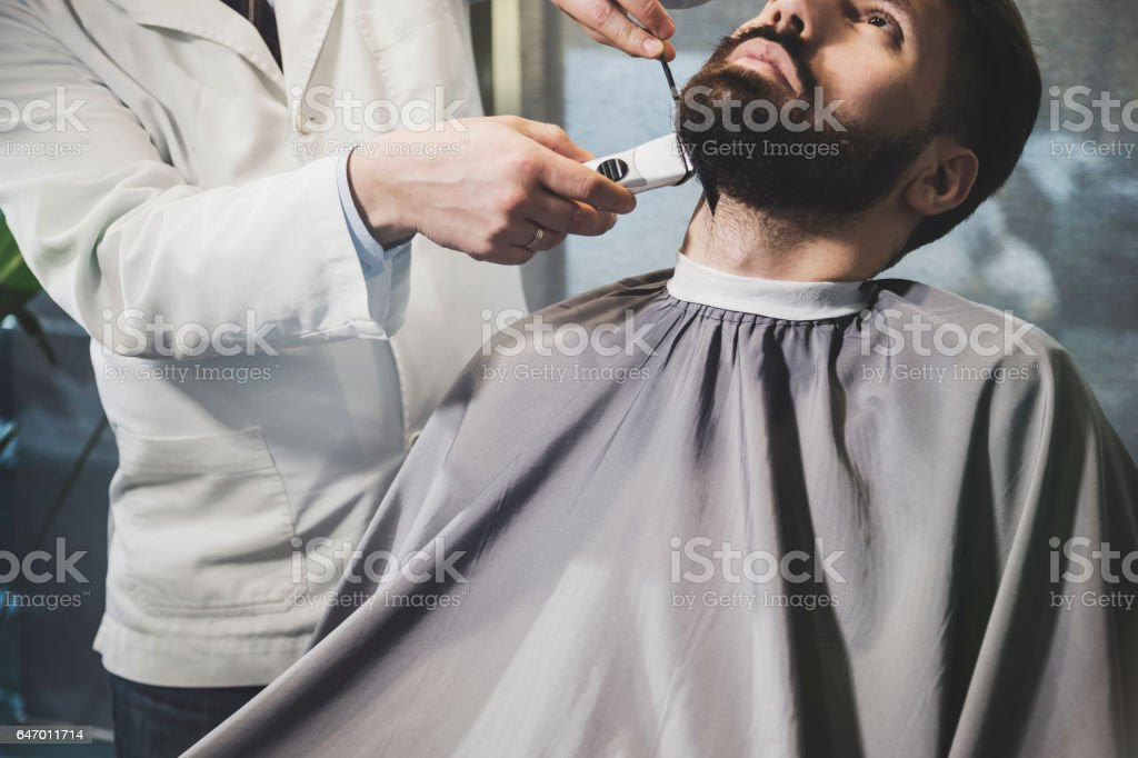 Front view of bearded businessman at a barber's stock photo
