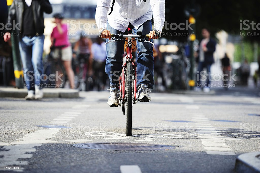 Front view of bicycle in bike lane and traffic royalty-free stock photo
