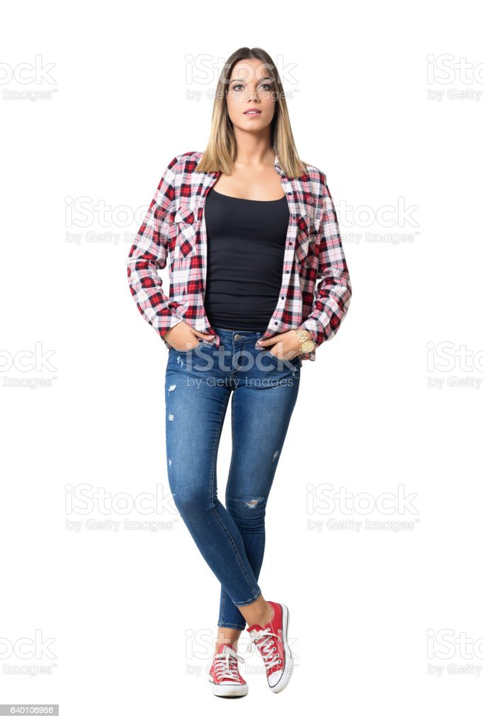 Front view of casual beautiful woman with hands in pockets stock photo