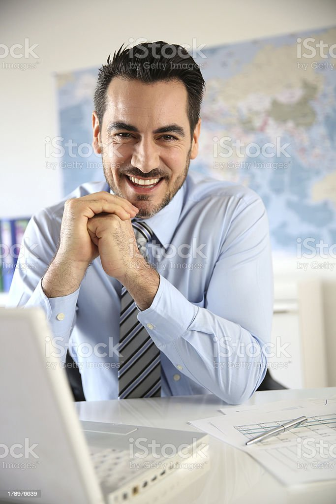 Front view of cheerful businessman sitting royalty-free stock photo