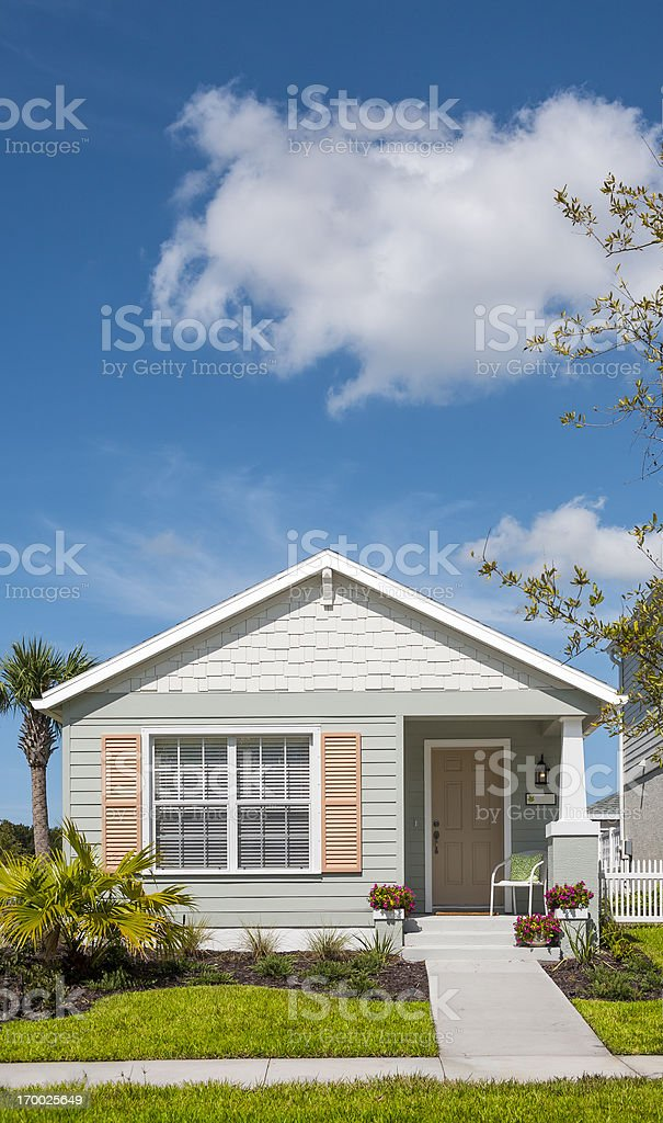 Front view of cottage house on sunny day stock photo
