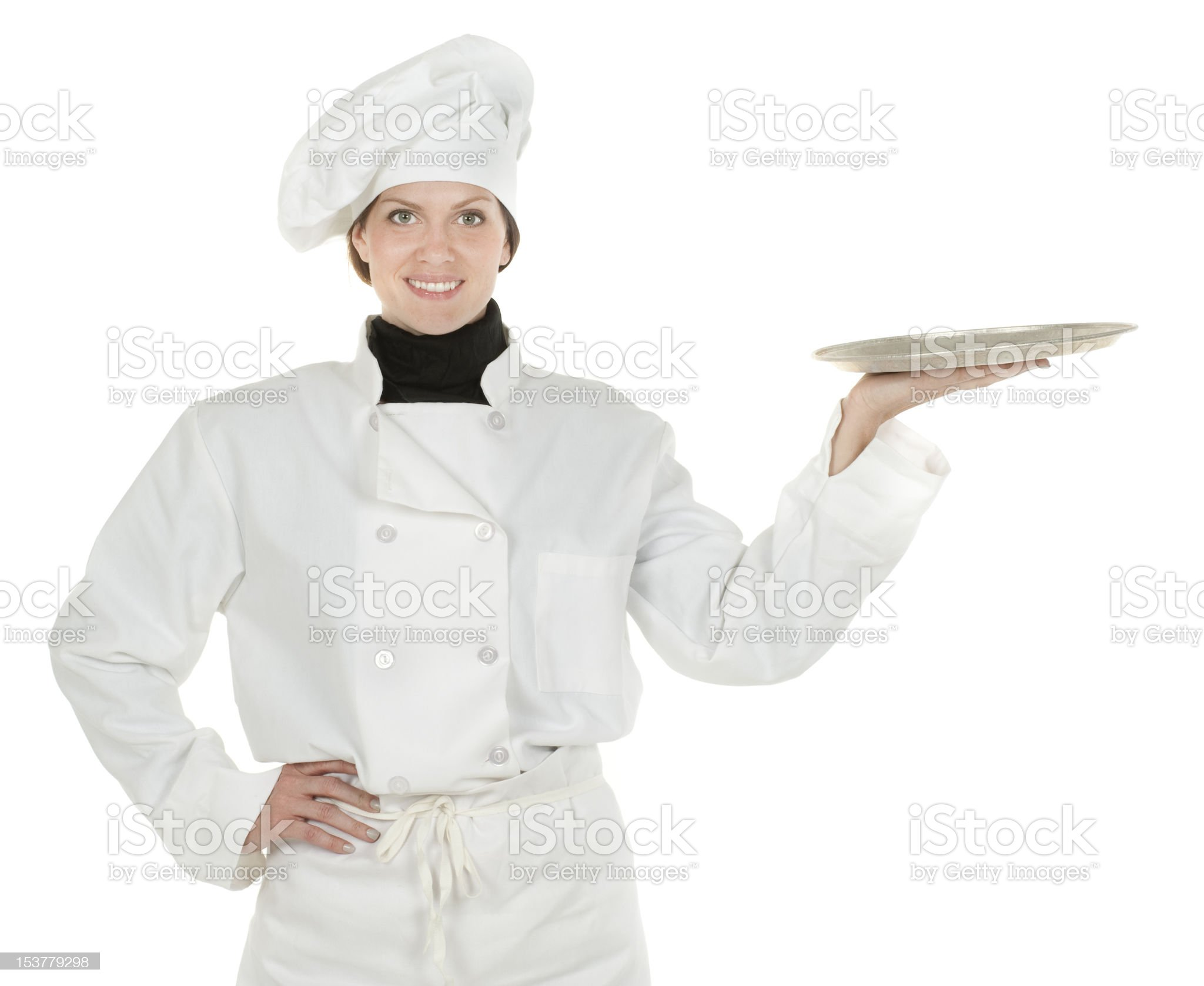 Front view of female chef holding platter. royalty-free stock photo