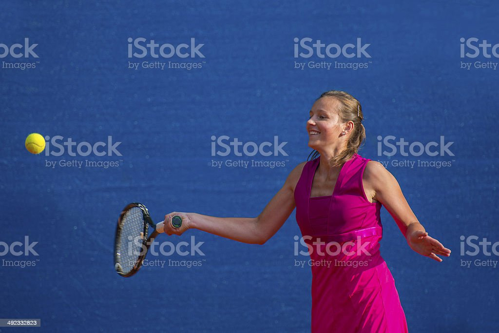 Front View of Female Tennis Player Smiling royalty-free stock photo