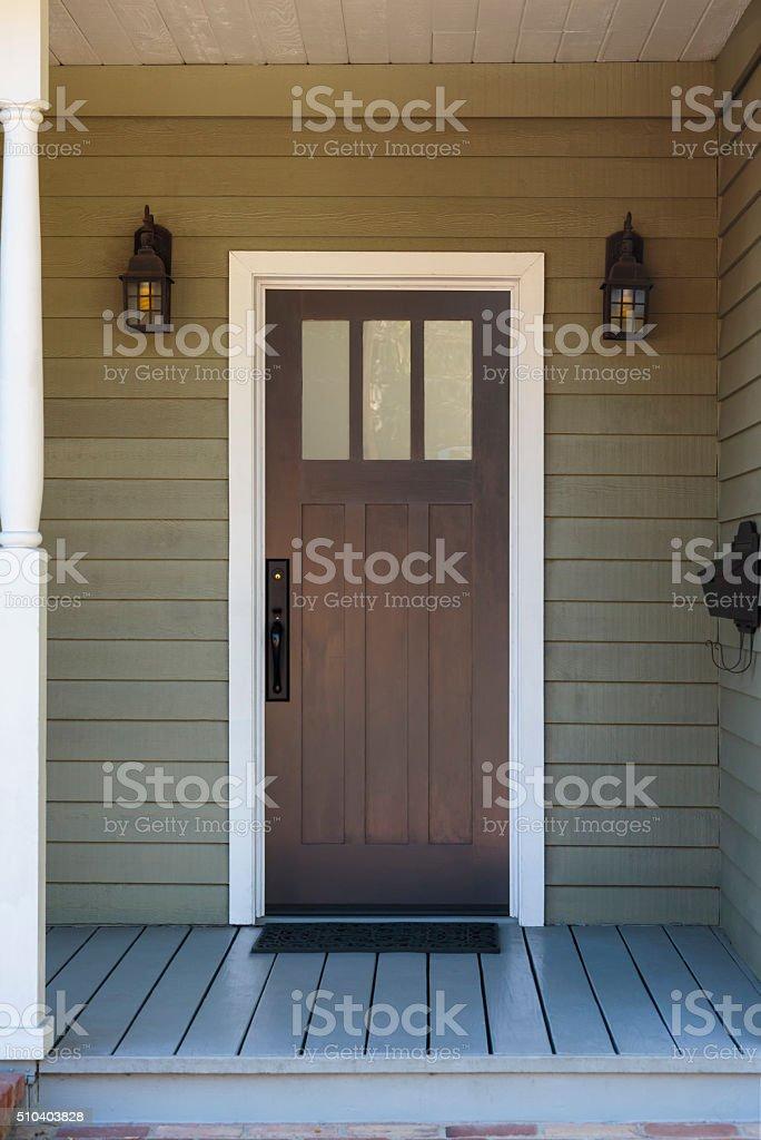 Front view of front door, brown stock photo