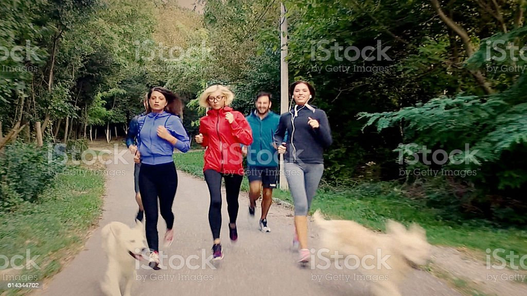 front view of group of athletes stock photo