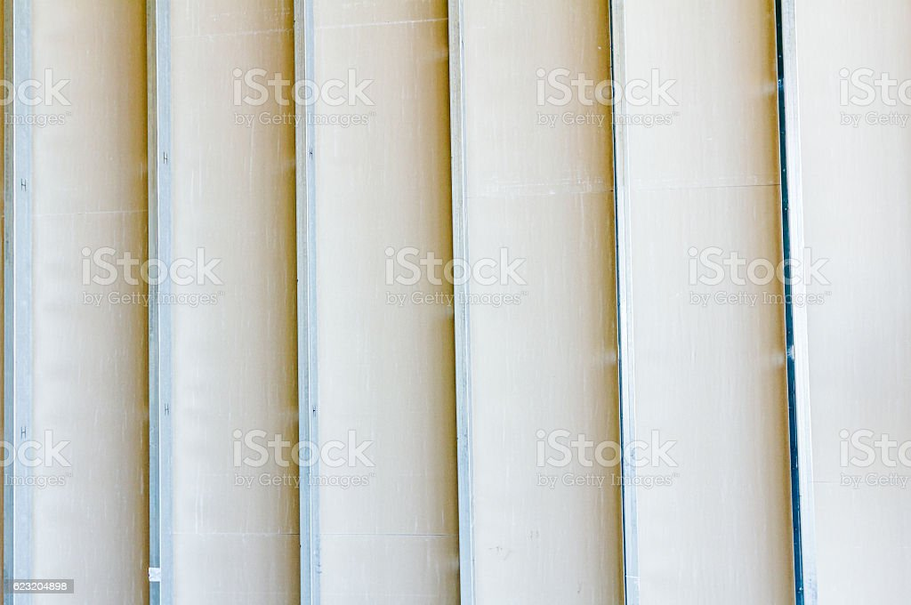 Front view of gypsum wall with galvanized steel joints stock photo