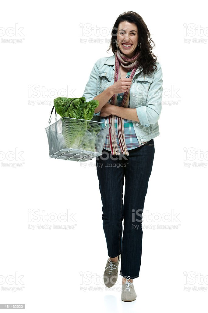 Front view of happy woman walking with basket royalty-free stock photo