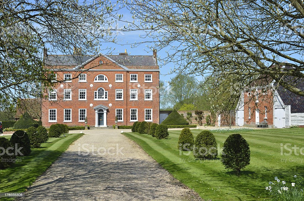 Front View of large Georgian Mansion with Drive stock photo