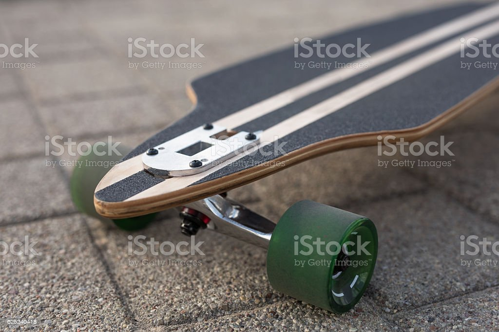 Front view of longboard stock photo