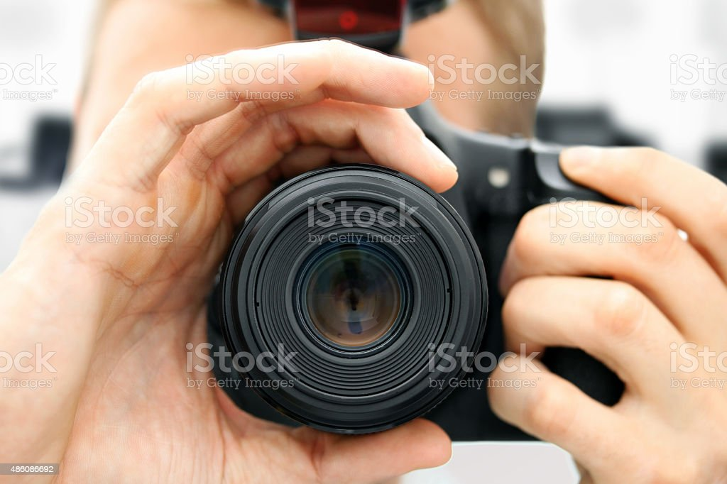 front view of man holding digital camera stock photo
