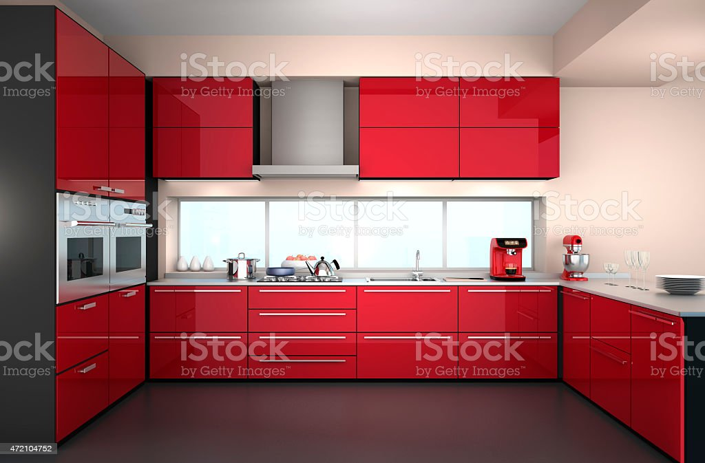 Front view of modern kitchen interior in red color theme. stock photo