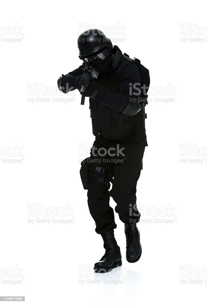 Front view of policeman in action with rifle royalty-free stock photo